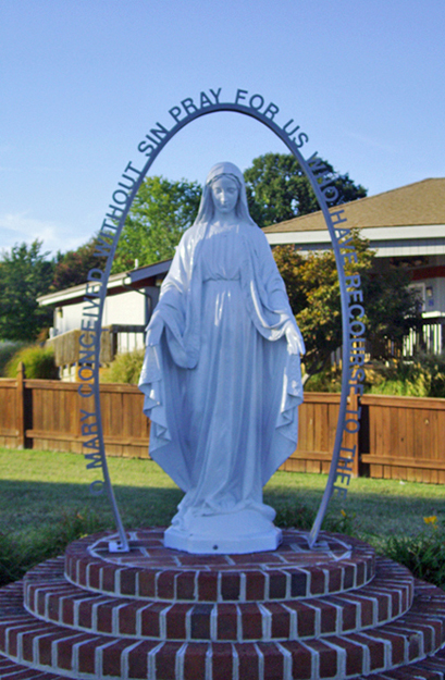 Mother of Light Shrine, placed in 1997 at St. Clement's Island Museum, Colton's Point, St. Mary's County, Maryland, with the Miraculous Medal prayer given to St. Catherine Laboure at Rue du Bac, Paris in 1830.  The inscription on one face of the marker begins:  Maryland was dedicated to Mary, the Mother of God, during the first Mass held on St. Clement's Island.